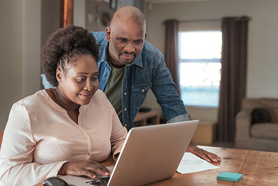 couple paying bills at home